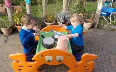Nursery drumming outdoors
