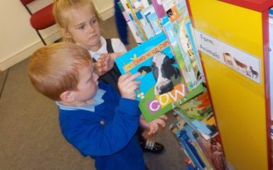 Reception visit the school library.